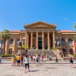 Palermo, Italy - August 16, 2014: tourists in front of famous opera house Teatro Massimo in Palermo, Sicily, Italy. It is the biggest in Italy, and one of the largest of Europe, renowned for its perfect acoustics.